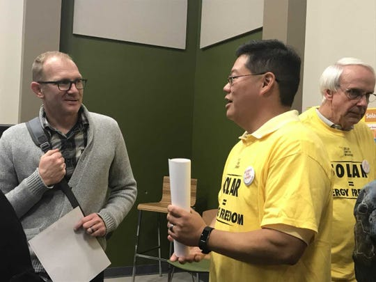 Kevin Yue, chairman of the Collier County Solar Co-op, left, shares information about the launch of the new initiative after a formal presentation at the Naples Botanical Garden on Jan. 17, 2019.