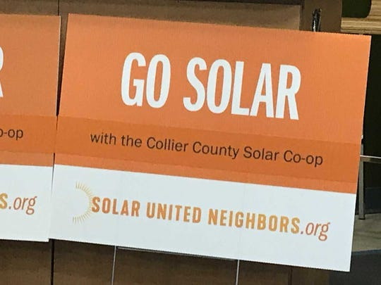 Signs promoting the launch of a new Solar Co-op in Collier County.
