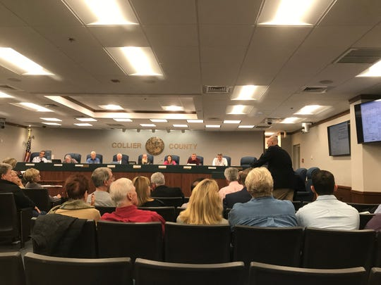 A proposed housing development in North Naples faced an onslaught of criticism from neighbors Thursday as Collier County planning commissioners put off a vote on the apartment project.
