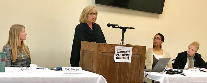 Beth Winegar, director of the Licking County Child Support Enforcement Agency, talks about raising her granddaughter, at a recent United Way forum on non-traditional families.