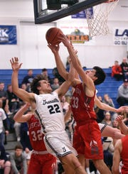 Granville's Cameron Crouch and Johnstown's Owen Hazelbaker fight for a rebound. The Blue Aces defeated the Johnnies 35-32 in double overtime on Wednesday, Jan. 16, 2019 at Granville High School.