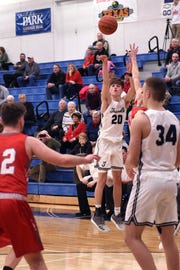 Granville's Brody Ley sinks a three pointer against Johnstown. Ley sunk a buzzer beater three later in the game to send the Blue Aces in to overtime.The Blue Aces defeated the Johnnies 35-32 in double overtime on Wednesday, Jan. 16, 2019 at Granville High School.