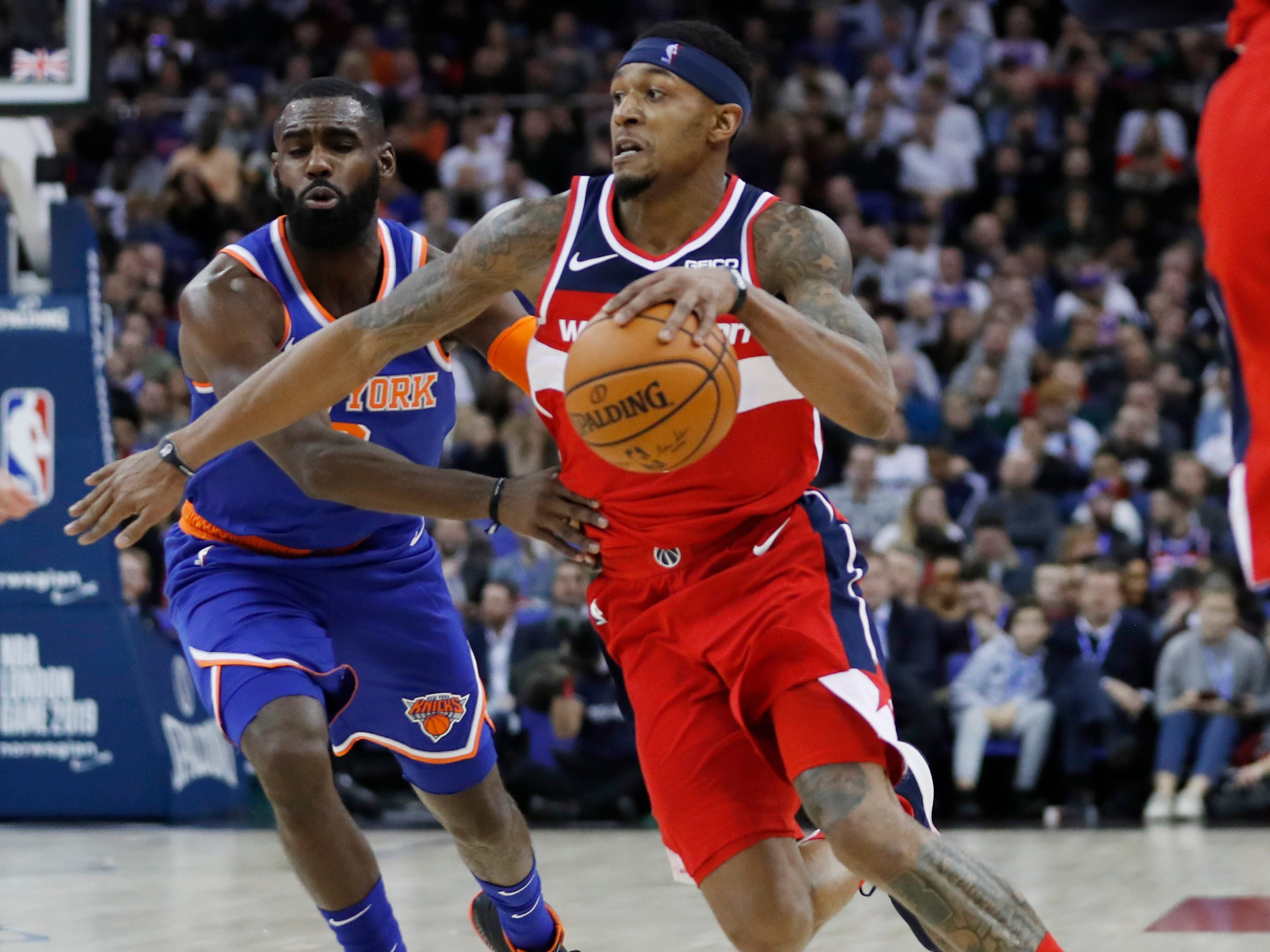 Washington Wizards guard Bradley Beal (3), right, drives to the basket as New York Knicks guard Tim Hardaway Jr. (3)defends, during an NBA basketball game between New York Knicks and Washington Wizards at the O2 Arena, in London, Thursday, Jan.17, 2019.