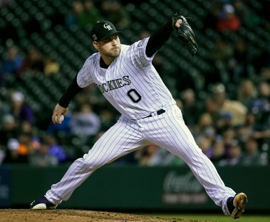 FILE - In this June 19, 2018, file photo, Colorado Rockies relief pitcher Adam Ottavino throws against the New York Mets during the seventh inning of a baseball game in Denver. A person familiar with the negotiations says reliever Adam Ottavino and the New York Yankees have agreed to a $27 million, three-year contract. The person spoke to The Associated Press on condition of anonymity Thursday, Jan. 17, 2019, because the deal was subject to a successful physical.