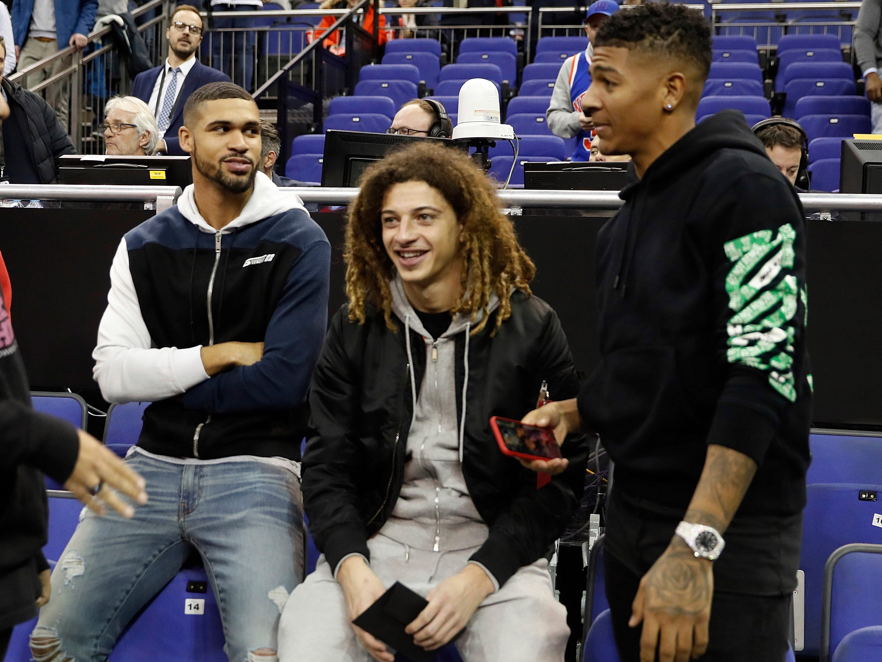 Chelsea's Ruben Loftus-Cheek, left, is flanked by Chelsea's Ethan Ampadu, center and Cristal Palace's Patrick van Aanholt attend an NBA basketball game between New York Knicks and Washington Wizards at the O2 Arena, in London, Thursday, Jan.17, 2019.