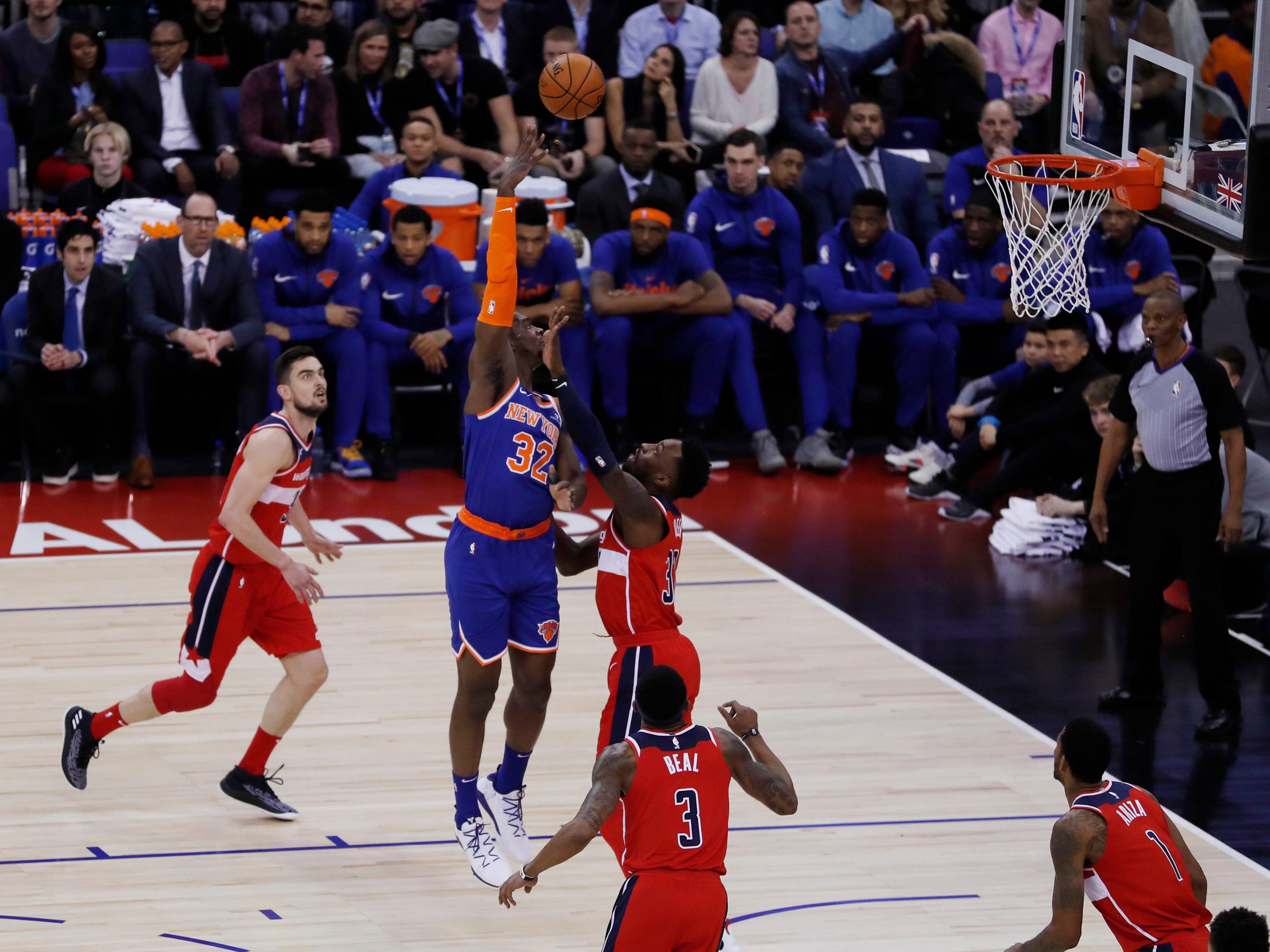 New York Knicks forward Noah Vonleh (32) shoots during an NBA basketball game between New York Knicks and Washington Wizards at the O2 Arena, in London, Thursday, Jan.17, 2019.