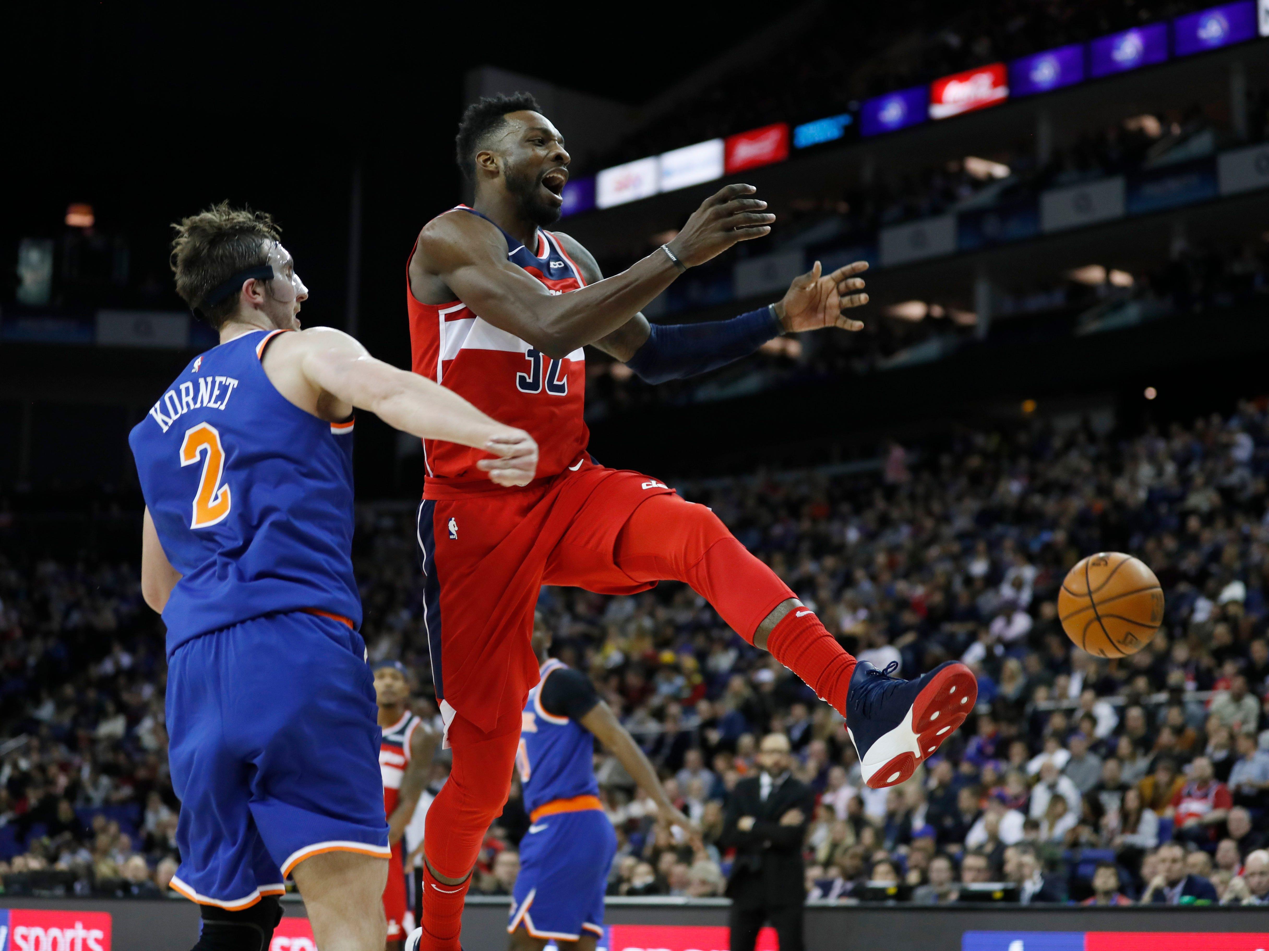 Washington Wizards forward Jeff Green (32), right, is fouled by New York Knicks forward Luke Kornet (2) during an NBA basketball game between New York Knicks and Washington Wizards at the O2 Arena, in London, Thursday, Jan.17, 2019.