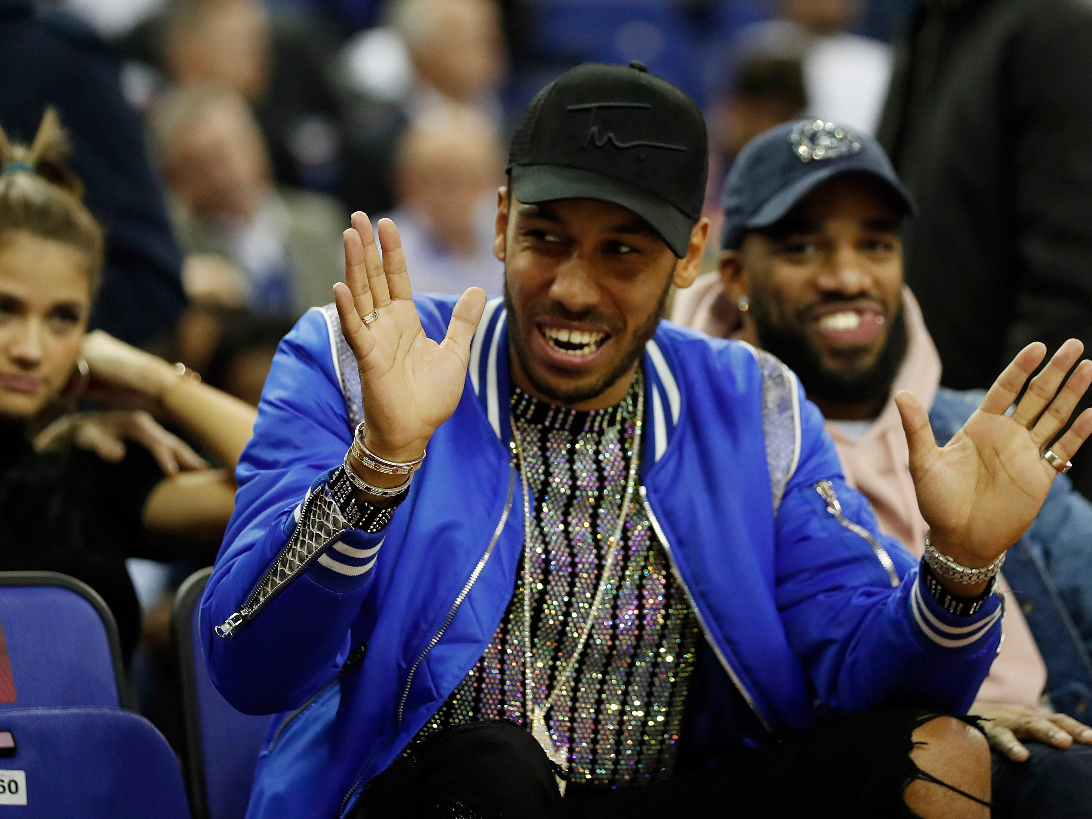 Arsenal player Pierre-Emerick Aubameyang gestures as he attends a NBA basketball game between New York Knicks and Washington Wizards at the O2 Arena, in London, Thursday, Jan.17, 2019.