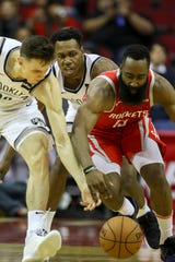 Jan 16, 2019; Houston, TX, USA; Houston Rockets guard James Harden (13) and Brooklyn Nets forward Rodions Kurucs (00) fight for a loose ball during the first quarter at Toyota Center.