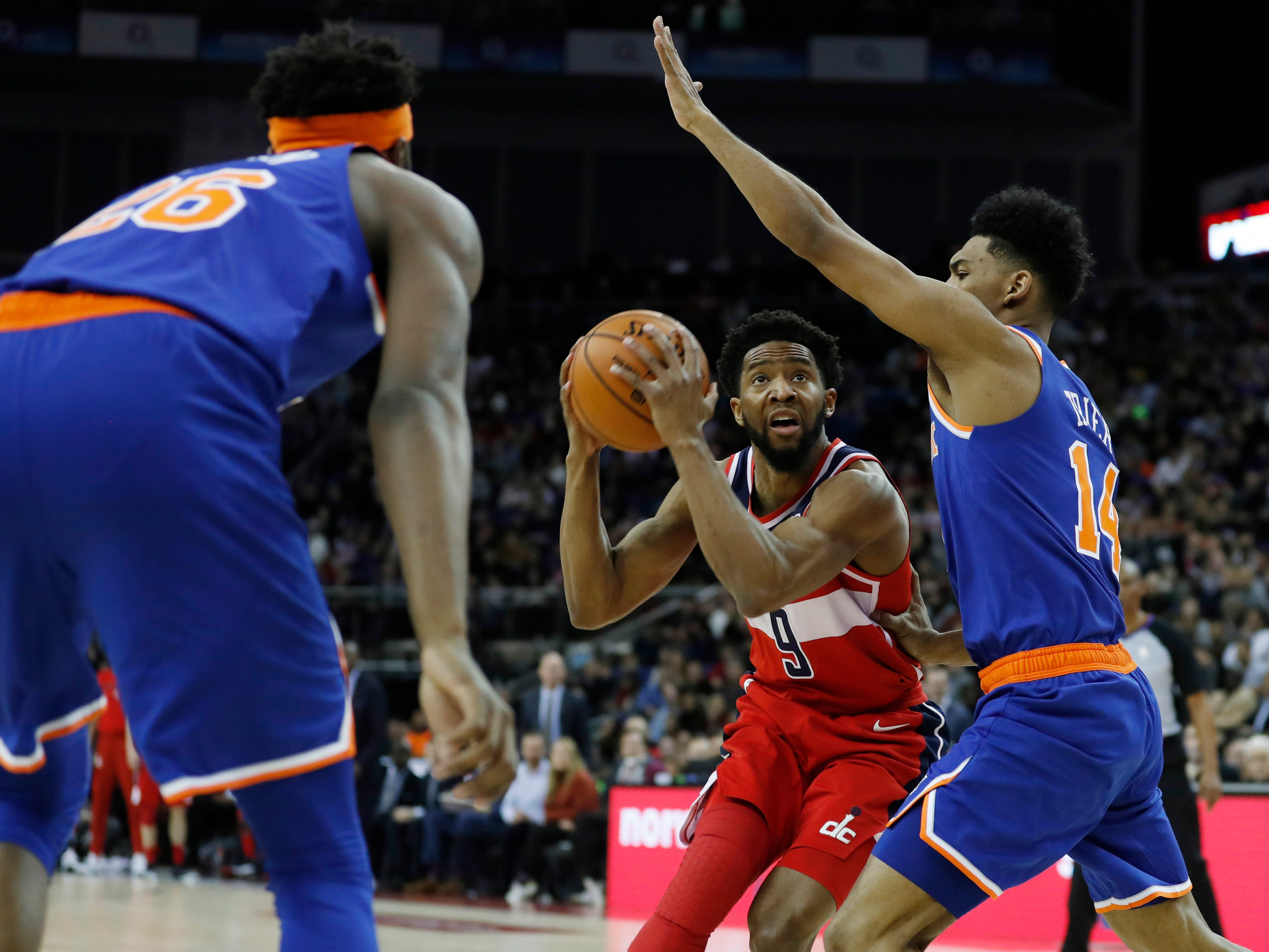 Washington Wizards guard Chasson Randle (9) drives to the basket as New York Knicks guard Allonzo Trier (14) defends, during an NBA basketball game between New York Knicks and Washington Wizards at the O2 Arena, in London, Thursday, Jan.17, 2019.