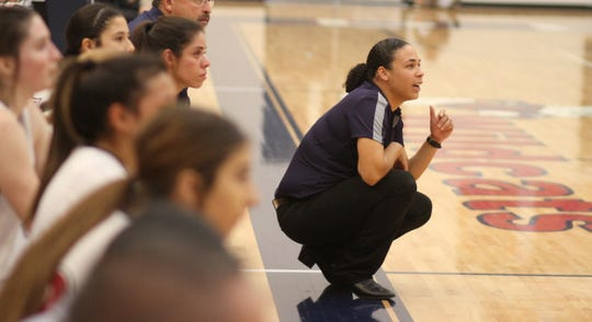 Deming High girls' basketball coach Kim Garcia watches the action unfold during Tuesday's home game against the Onate high Knights.