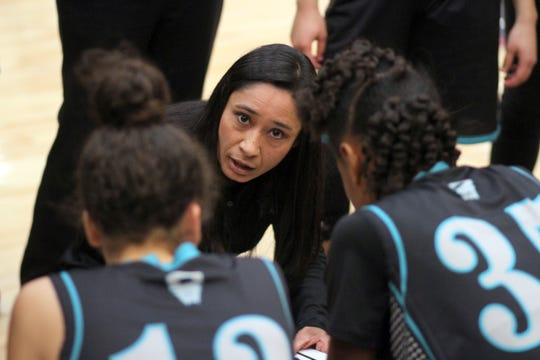 Onate Knights Head Coach Evelyn Reyes talks strategy during a time out at Tuesday's District 3-5A game at Deming High. The Knights defeated the Lady 'Cats 57-51.