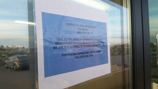 A sign on the door of the U.S. Bureau of Land Management's Las Cruces office, 1800 Marquess St., states on Wednesday, Jan. 16, 2019 that employees aren't at work because of an ongoing federal government shutdown. The Department of the Interior, which includes the BLM, is among the affected agencies.