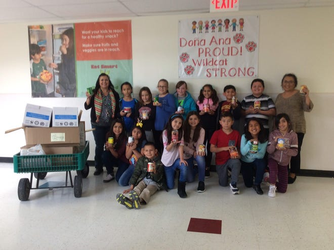 Students from the Doña Ana Elementary Student Council pose with food donations the organization collected in December to benefit Casa de Peregrinos. The food drive raised more than 200 cans of food for the local food program.