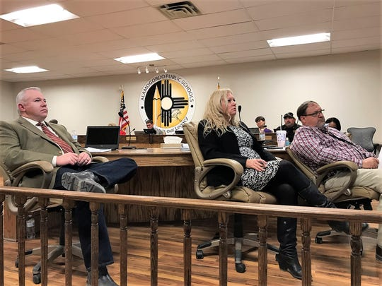 From left to right: Alamogordo Public Schools Chief of Capital Outlay and Facilities Justin Burks, APS Deputy of Support and Human Resources Colleen Tagle and APS Chief of Staff Doyle Syling listen to the APS 2018 regular audit presentation by Jaramillo Accounting Group Wednesday evening.