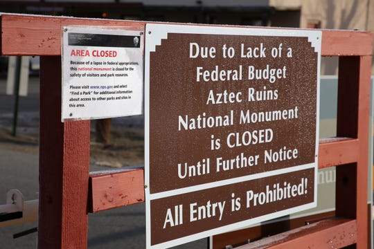 A sign outside Aztec Ruins National Monument informs visitors the park is closed Thursday in Aztec.