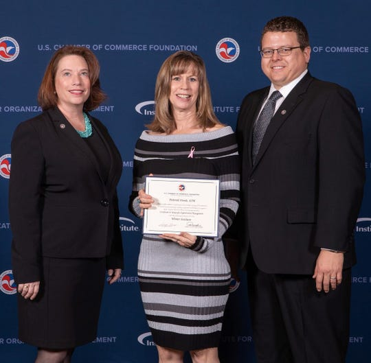 Deborah Douds is pictured center with two Institute for Organization Management officials after graduation ceremonies at the University of Arizona-Tucson Jan. 9.