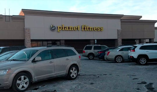 Police say a suspect stole a purse from the back seat of a vehicle parked outside the Planet Fitness near Seven Mile and Middlebelt.