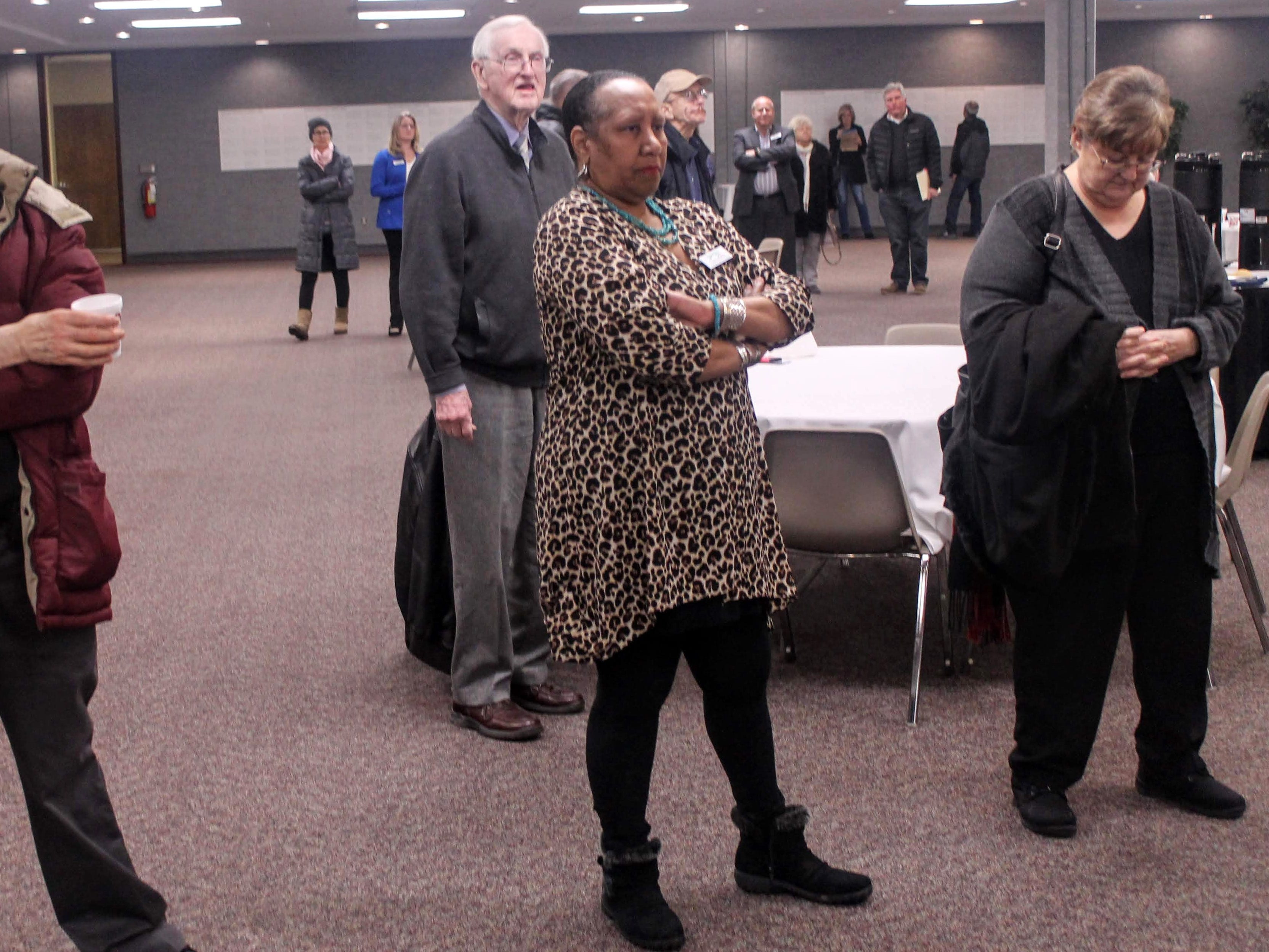 Residents and interested stakeholders listen to a short presentation on the future of Harrison High School Jan. 16 in the Costick Center in Farmington Hills.