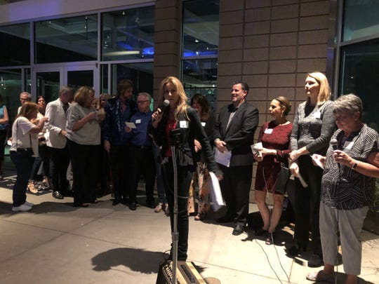 Melissa Neiderman leads the way as 31 volunteers line up to speak, united in their support of ACS