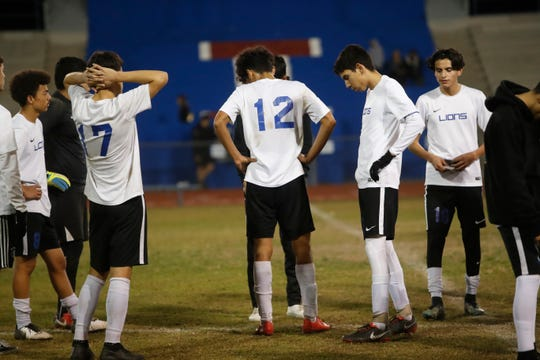 Cathedral City High School soccer players react after being down in the first half of their game against Indio High School.