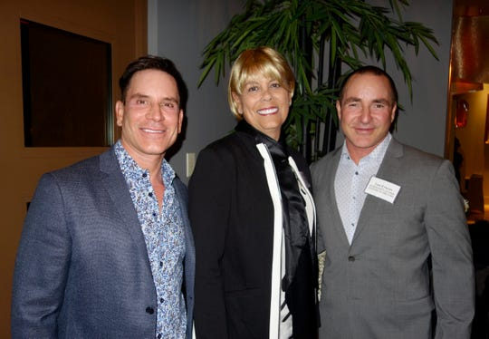 Amy Baker, host of the event is flanked by Visionary Patrons (L) Tim Jochen and Lee Erwin. Erwin's a busy guy as he's also board treasurer and an event co-chair.
