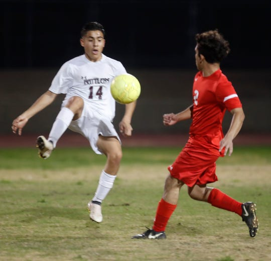 Palm Desert High School's Mikey Castro, at right, battles for control of the ball against Jordy Baez of Rancho Mirage High School on January 16, 2019.