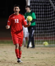 Palm Desert High School's Elias Duque celebrates his team's goal against Rancho Mirage High School on January 16, 2019.