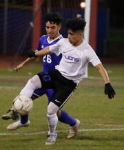 Cathedral City High School's Leyver Guzman drives the ball during their game against Indio High School.