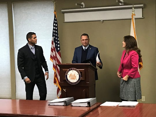 La Quinta Mayor Pro Tem Steve Sanchez (from left), County Supervisor V. Manuel Perez and Mayor Linda Evans chat among themselves before a news conference announcing the findings of a county investigation into a racially charged incident at the La Quinta library.
