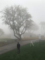 Fog blankets the first tee of the Nicklaus Tournament Course at PGA West Thursday morning