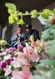 Surrounded by flowers from well-wishers, Davisa and Earl Banks talk about the loss of their son Sean and daughter Antoinette with a Virginia newspaper via phone at their home in Pensacola on Thursday, January 17, 2019.  Sean Banks, 15, and Antoinette McCoy, 22, were killed by a suspected drunk driver in a car crash early Saturday morning.