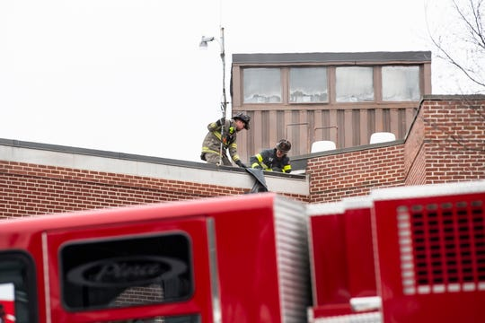 Firefighters work on the roof of WellSpan Gettysburg Hospital at 147 Gettys St. while responding to a report of a commercial fire on Thursday, Jan. 17, 2019. Over 30 units responded to the scene.
