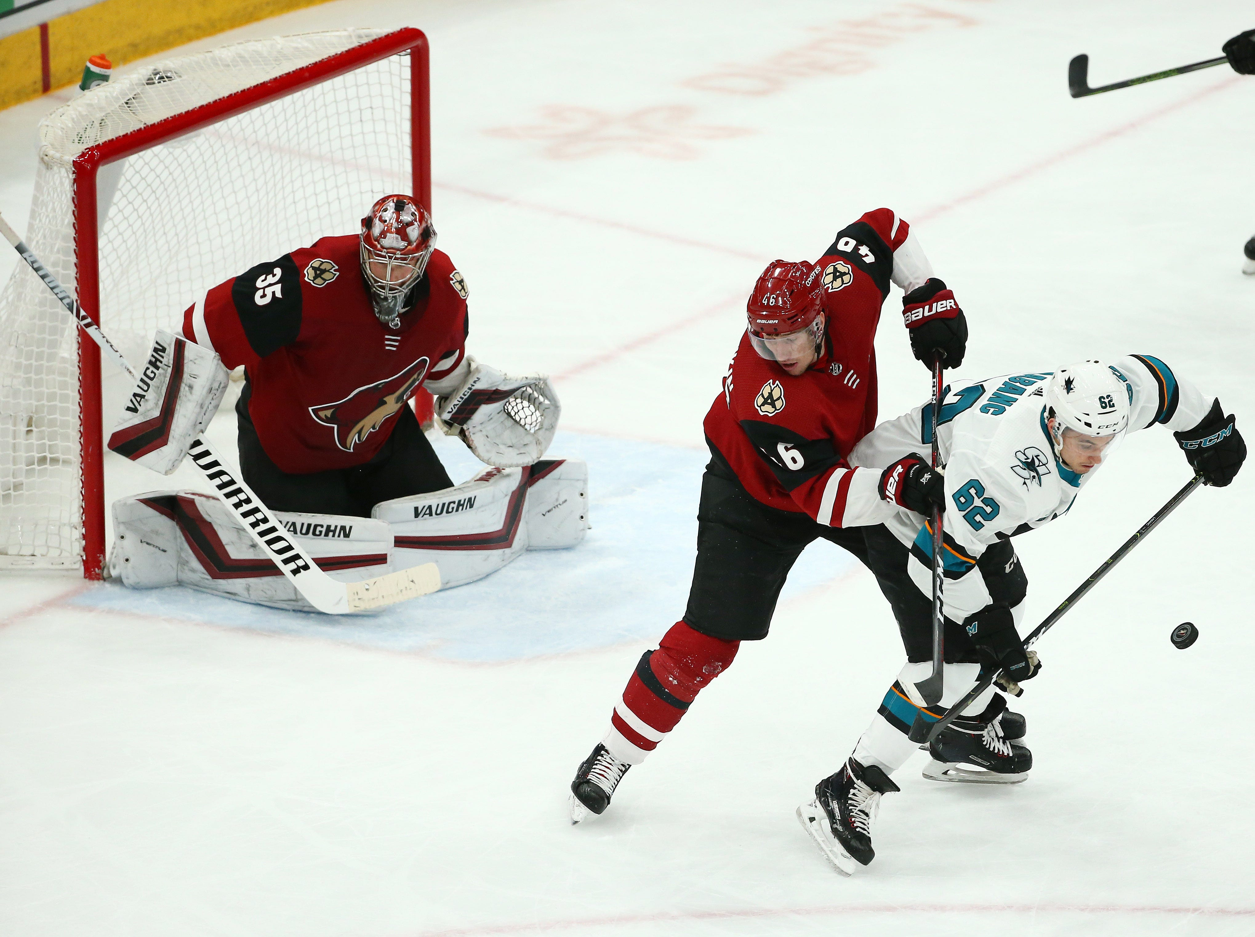 Arizona Coyotes' Ilya Lyubushkin (46) battles with San Jose Sharks' Kevin Labanc in the 1st period on Jan. 16 at Gila River Arena.