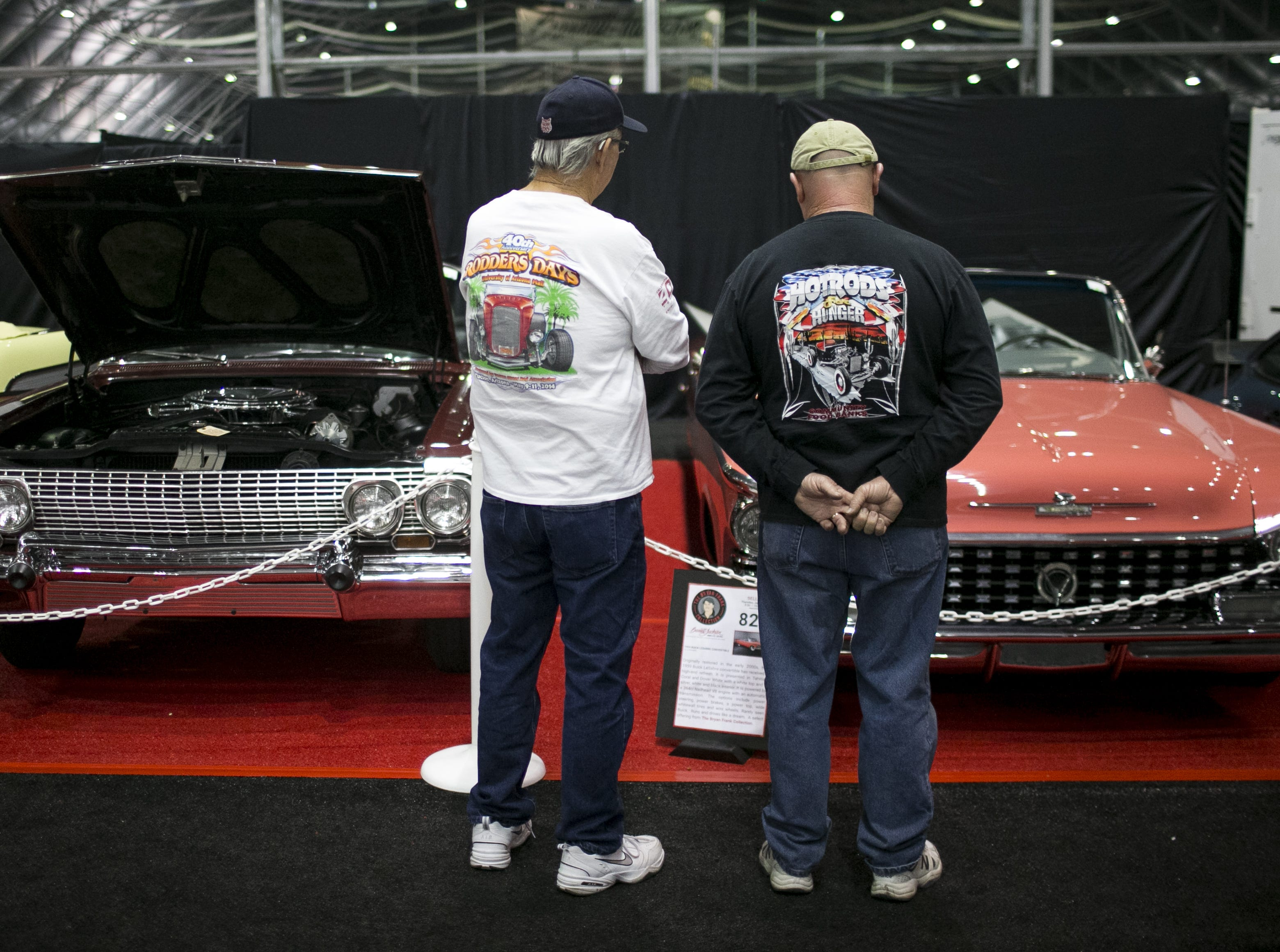Glenn Looney (left) and Randy Glazebrook (right) look at a 1959 Buick Lesabre at the Barrett-Jackson Car Auction at WestWorld in Scottsdale, Arizona, on Jan. 16, 2019.
