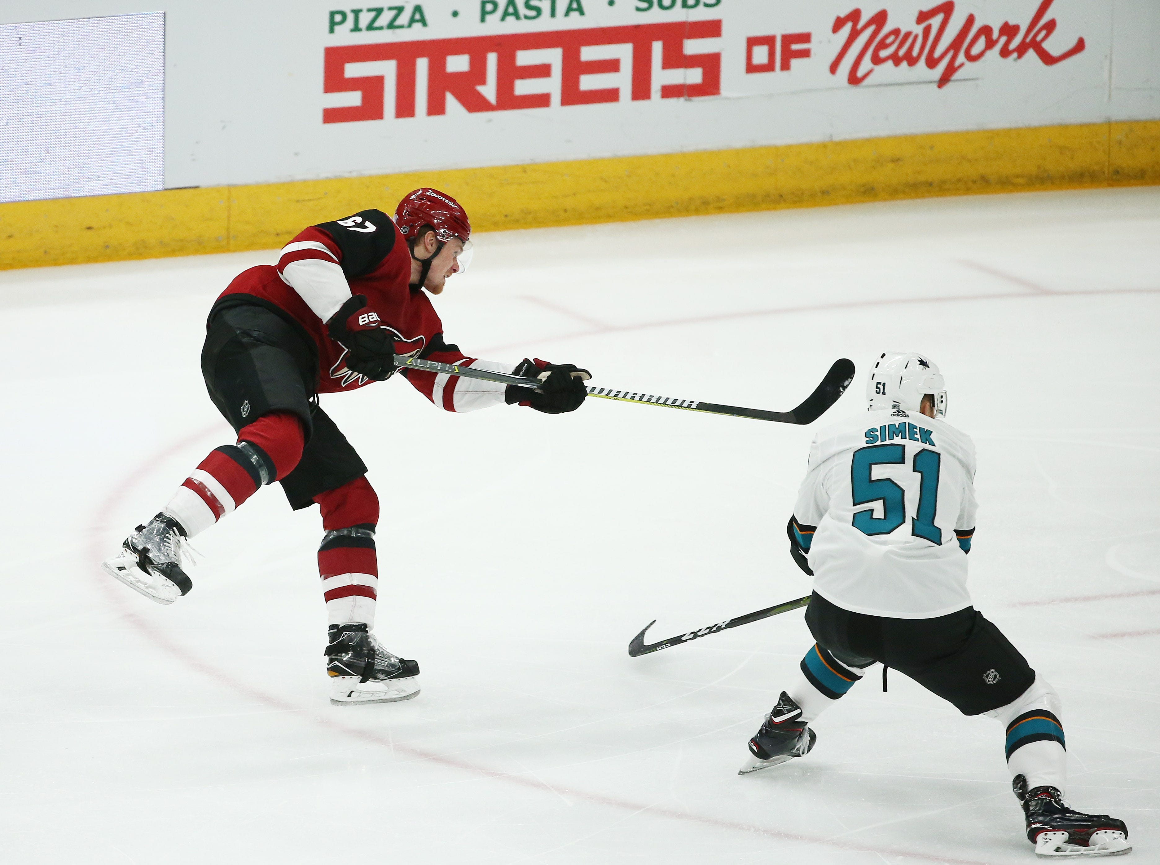 Arizona Coyotes' Lawson Crouse (67) scores a goal against the San Jose Sharks in the 1st period on Jan. 16 at Gila River Arena.