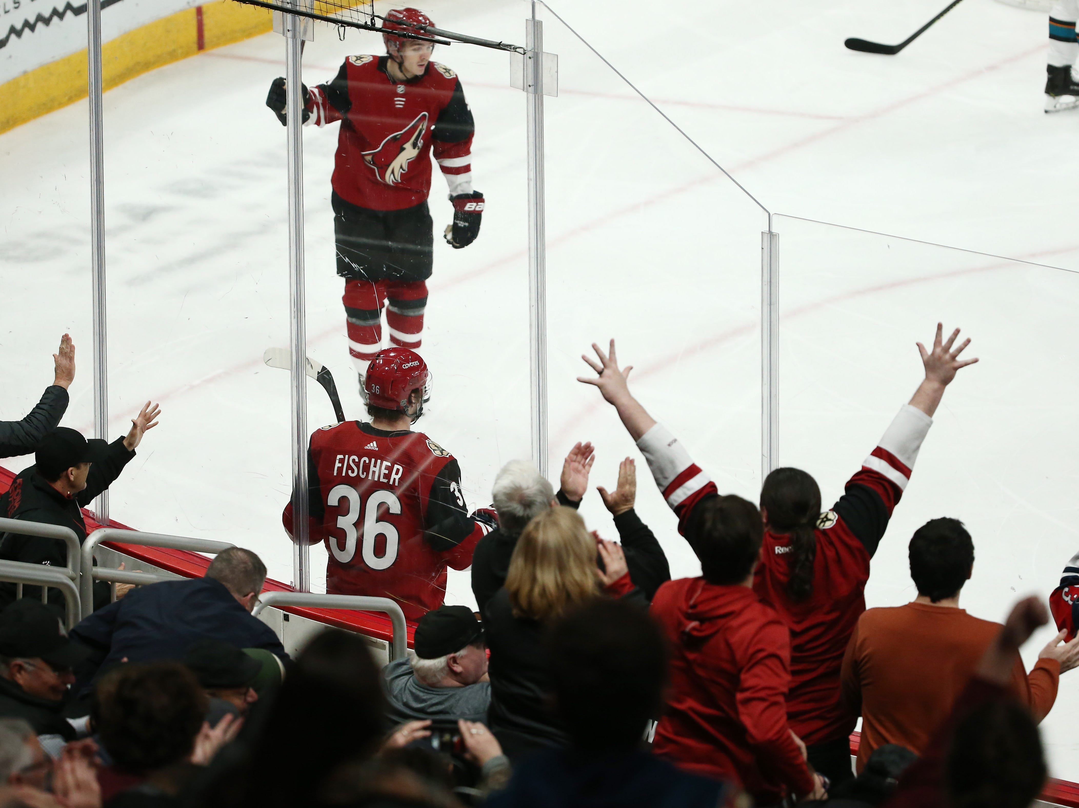 Arizona Coyotes' Christian Fischer (36) celebrates after scoring a goal against the San Jose Sharks in the 2nd period on Jan. 16 at Gila River Arena.