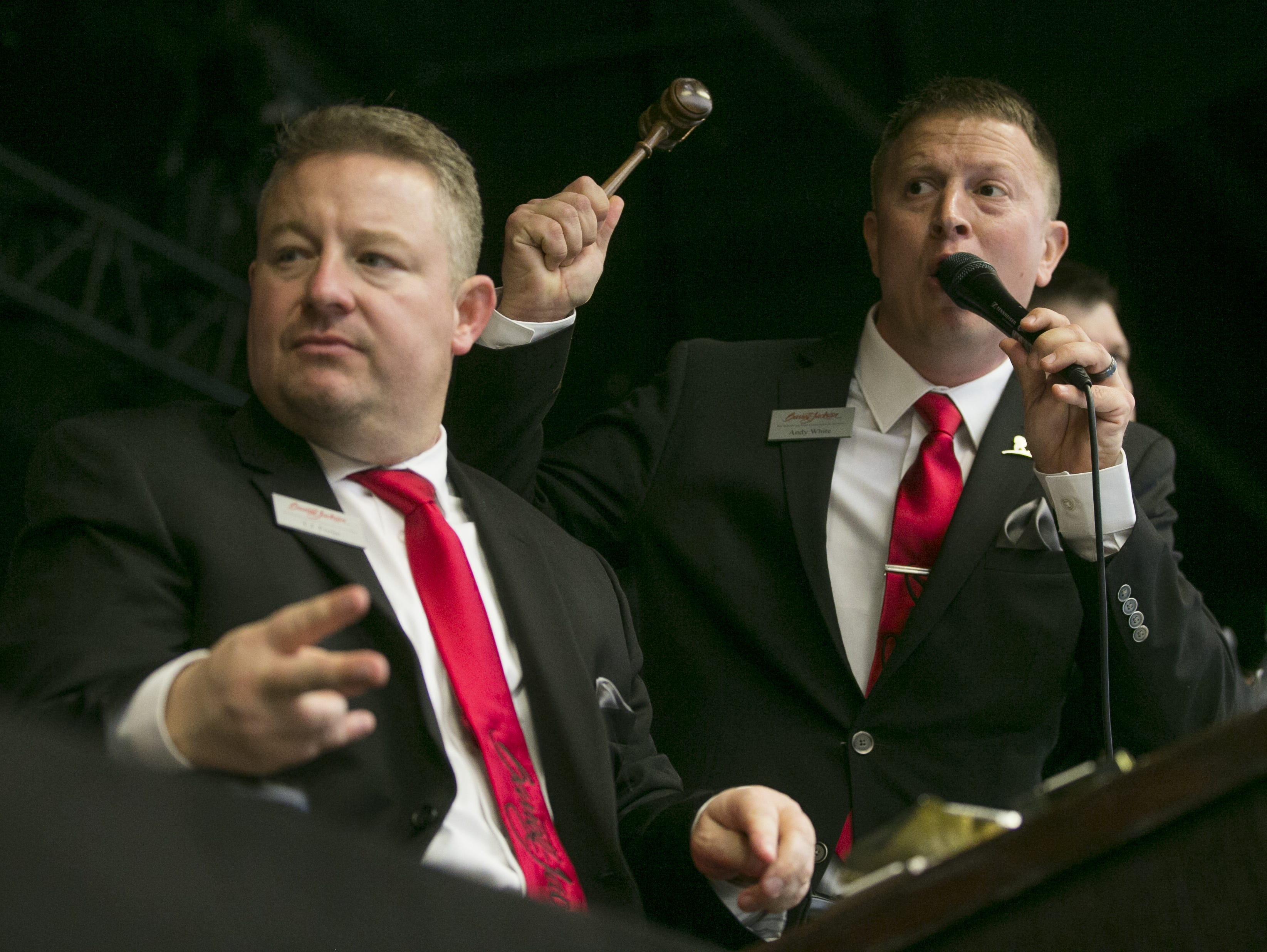 Andy White (right) auctions off cars at the Barrett-Jackson Car Auction at WestWorld in Scottsdale, Arizona, on Jan. 16, 2019.