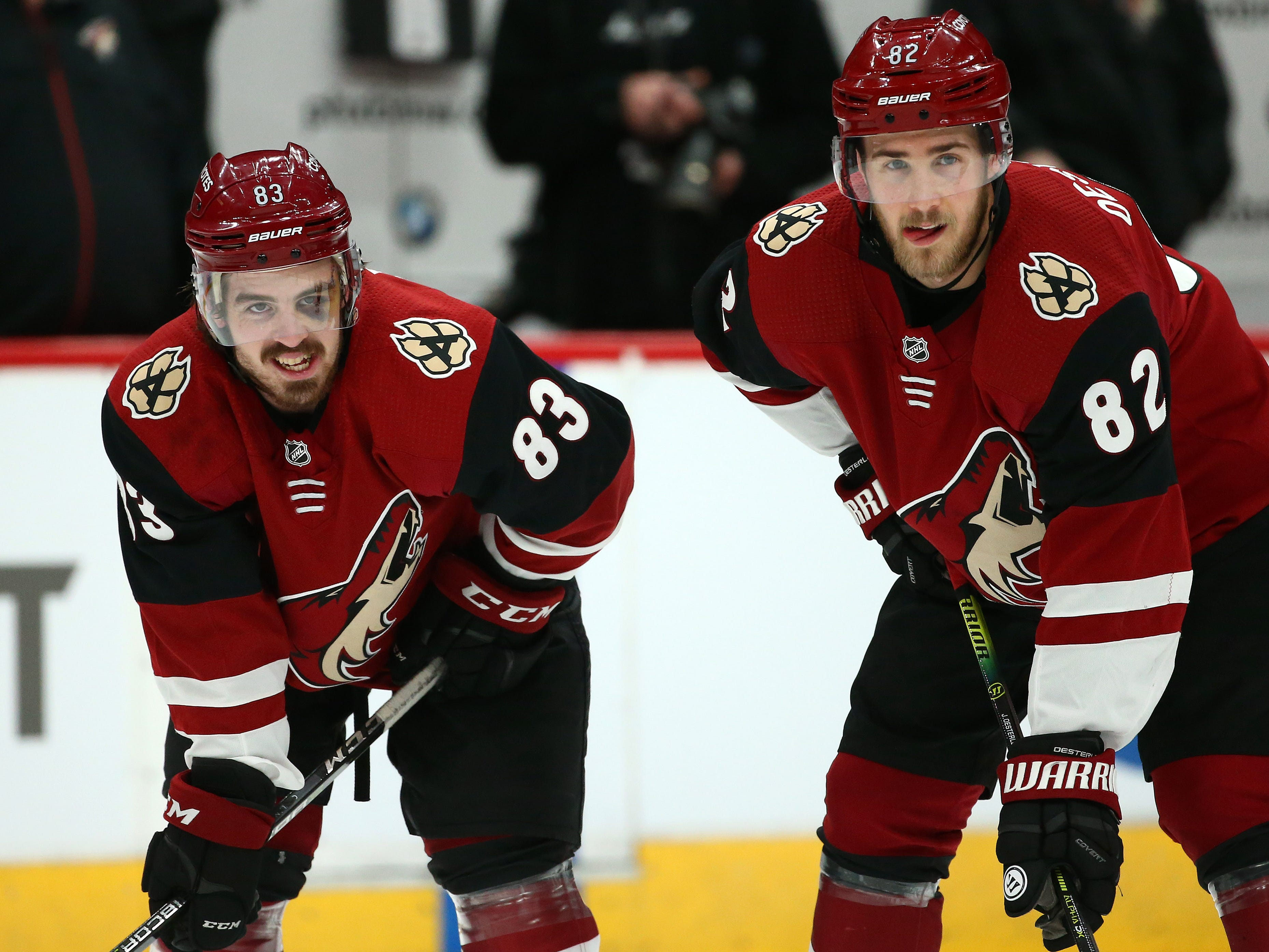 Arizona Coyotes rookie Conor Garland (83) and Jordan Oesterle (82) during warm-ups before playing the San Jose Sharks on Jan. 16 at Gila River Arena.