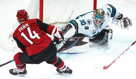 Coyotes winger Richard Panik has a shot blocked by Sharks goaltender Aaron Dell during the second period of a game Jan. 16 at Gila River Arena.
