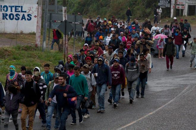 Honduran migrants walk along the roadside through Esquipulas, Guatemala, as they make their way toward the U.S. border, early Wednesday, Jan. 16, 2019. The latest caravan of Honduran migrants hoping to reach the U.S. has crossed into Guatemala.