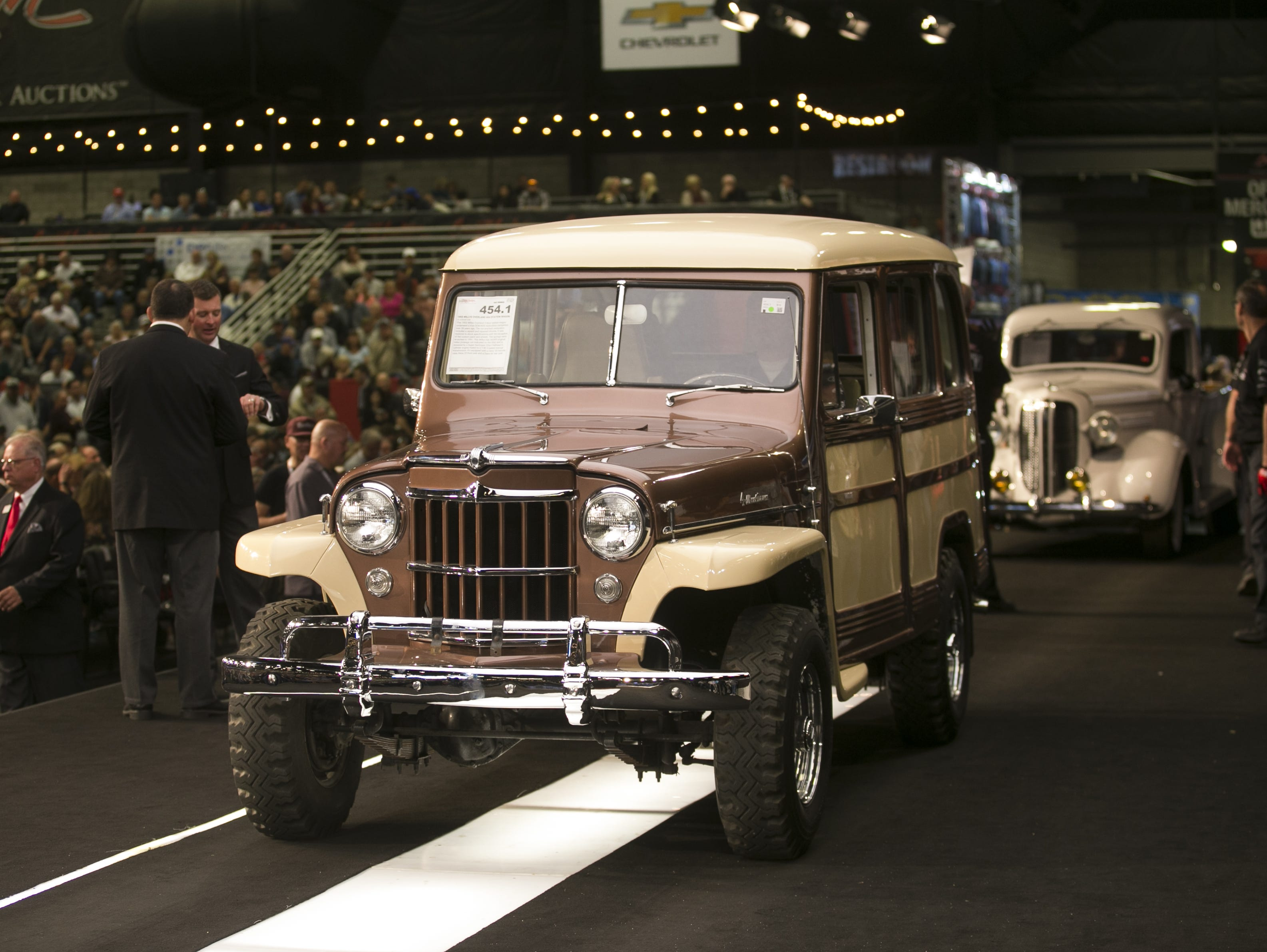A 1955 Willy's Overland Station Wagon is auctioned at the Barrett-Jackson Car Auction at WestWorld in Scottsdale, Arizona, on Jan. 16, 2019.