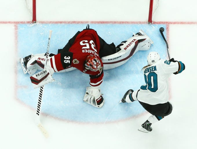 San Jose Sharks' Marcus Sorensent misses the shot against Arizona Coyotes goalie Darcy Kuemper in the second period on Jan. 16 at Gila River Arena.