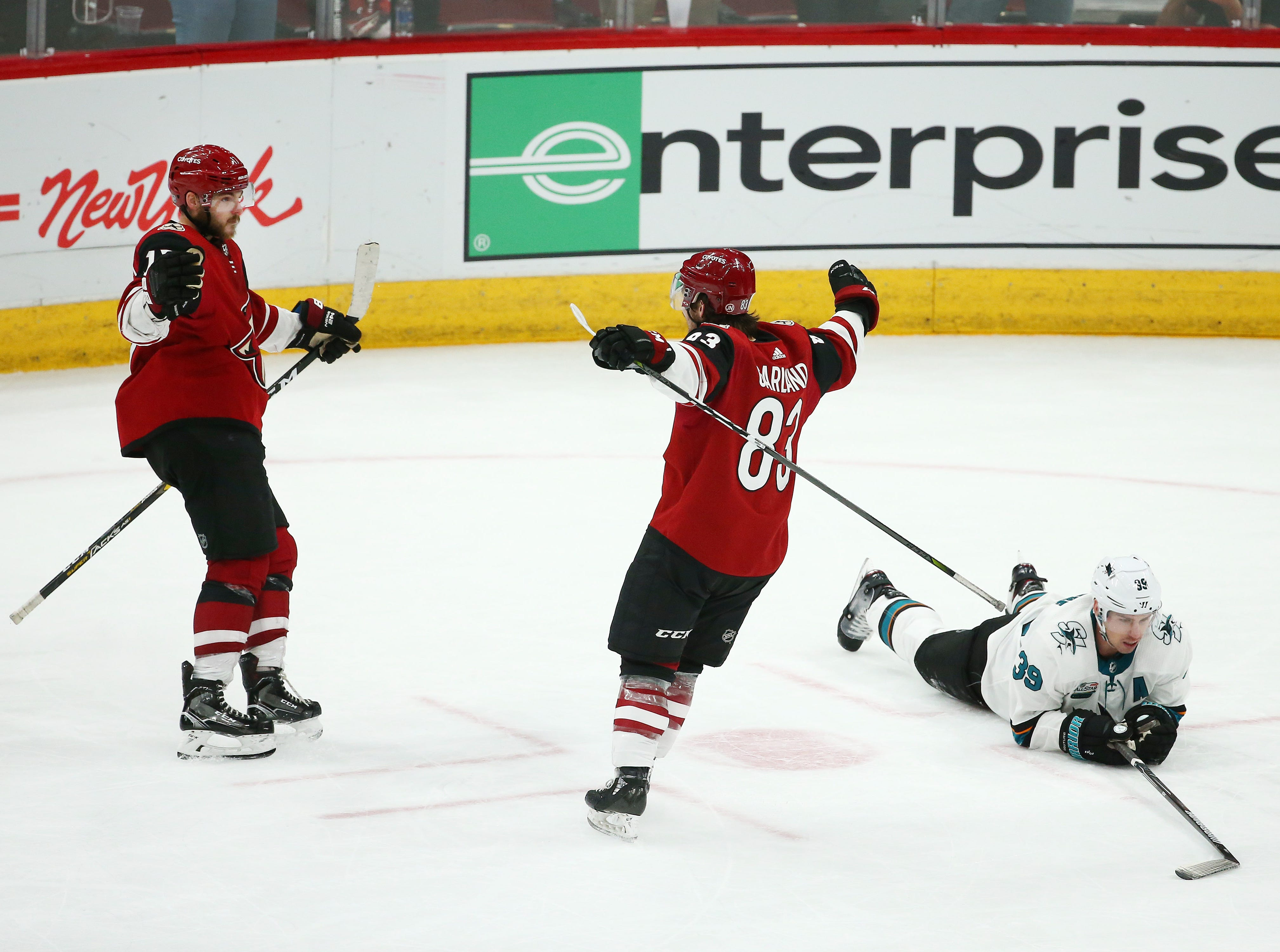 Arizona Coyotes Alex Galchenyuk (left) scores a goal against the San Jose Sharks in the third period on Jan. 16 at Gila River Arena.