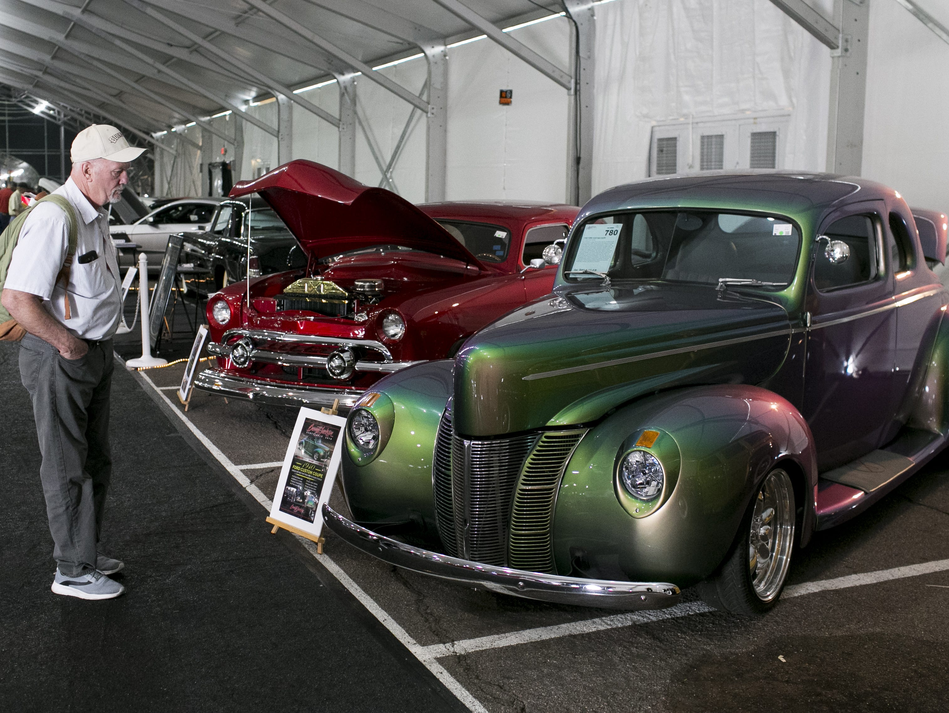 Pat McFarland (left), visiting from Tacoma, Washington, looks at a 1940 Ford Custom Coupe at the Barrett-Jackson Car Auction at WestWorld in Scottsdale, Arizona, on Jan. 16, 2019.