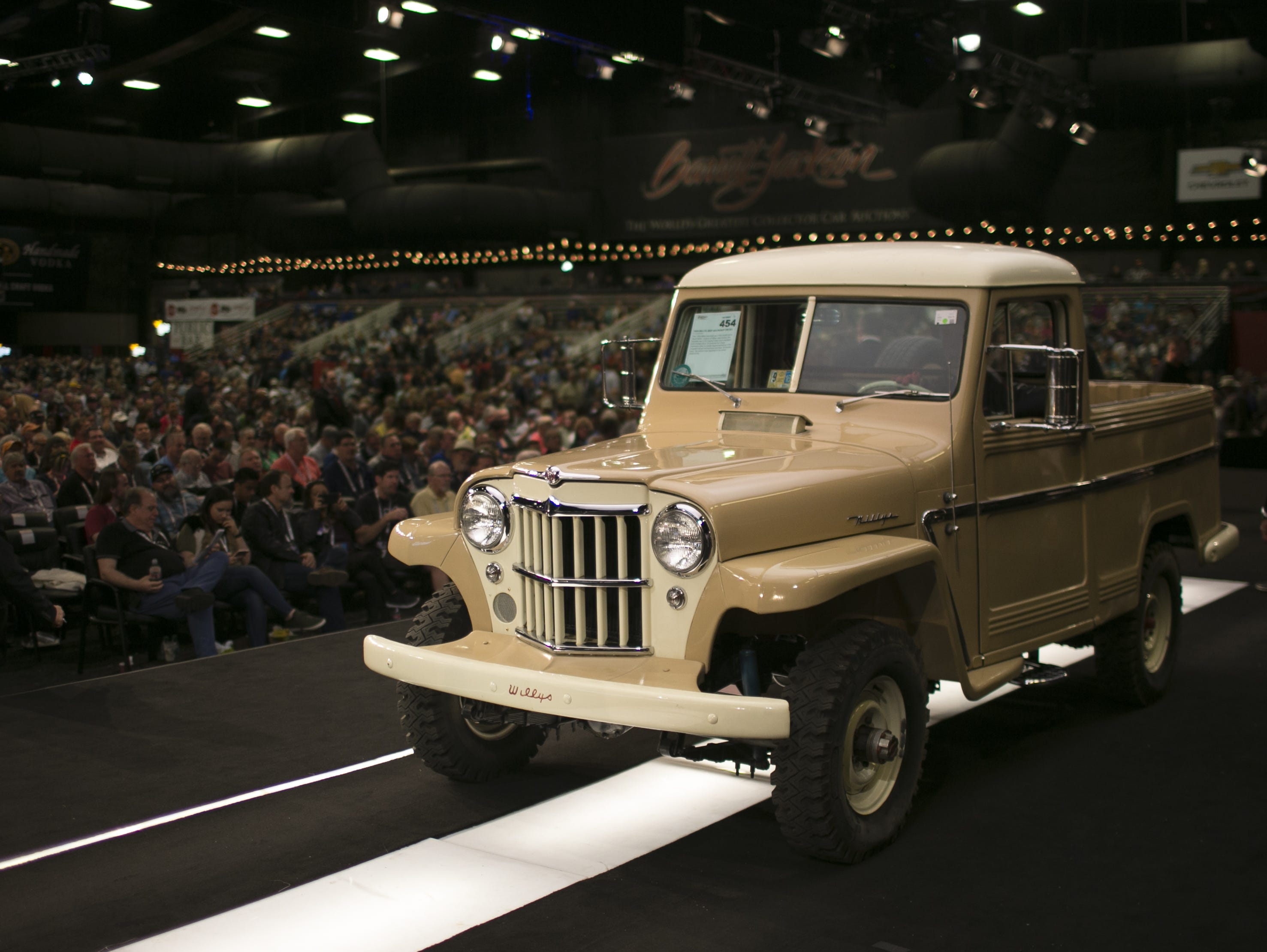 A 1954 Willy's Jeep is auctioned at the Barrett-Jackson Car Auction at WestWorld in Scottsdale, Arizona, on Jan. 16, 2019.