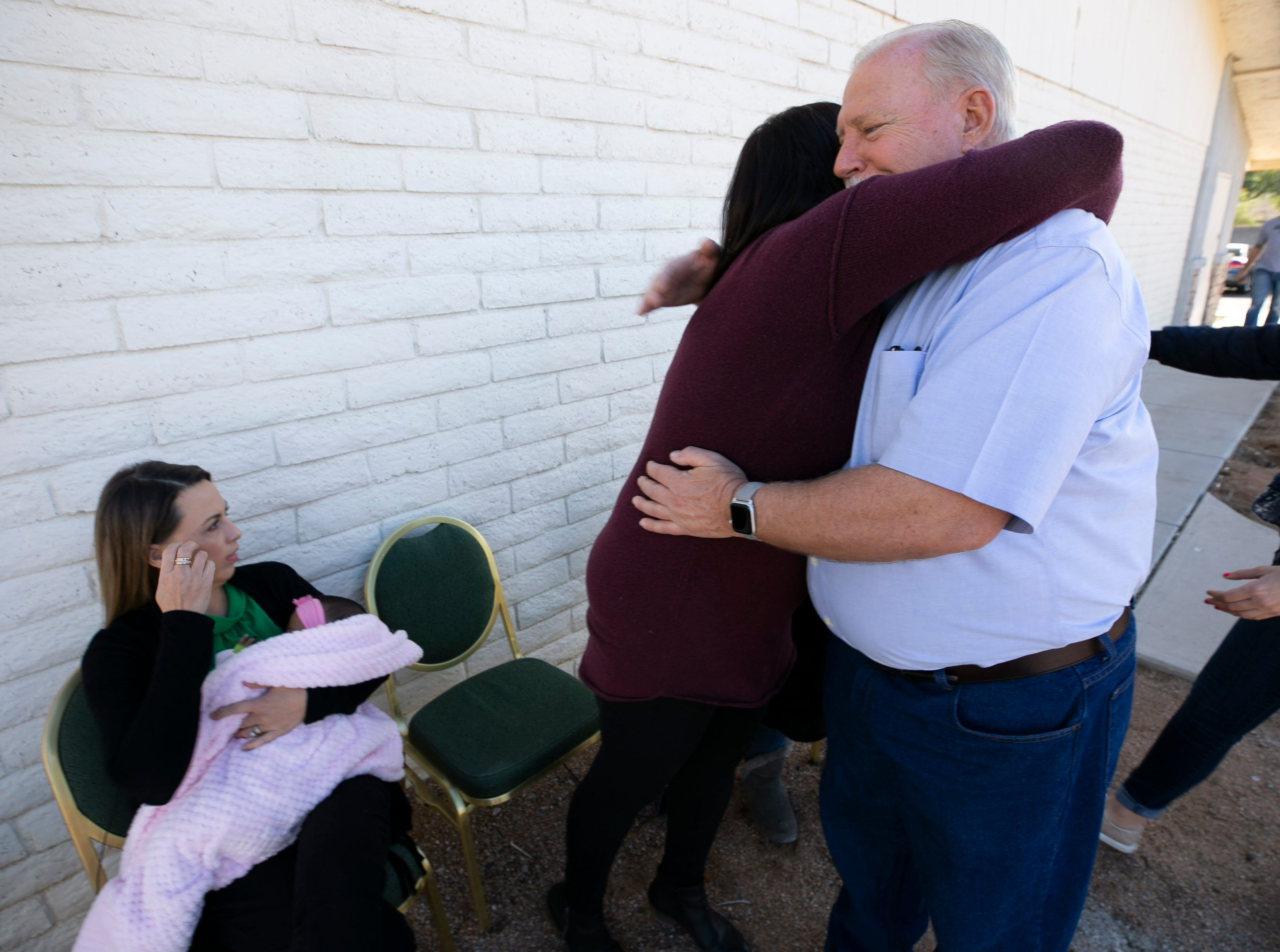 Randy Hansen of Mesa hugs Susan Woodruff, vice president and co-founder of ASA Now, as Anika Robinson, president and co-founder of ASA Now, looks on at the yet-to-be-opened Jacob's Mission Community Center in Mesa on Jan. 14, 2019. Randy and his wife, Leslie Hansen, made a million-dollar donation to ASA Now, which is creating the community center that will provide support to foster-care families. Hansen made the donation paying off ASA Now's mortgage on the building for the community center after reading a story about ASA Now in The Arizona Republic/azcentral.com.
