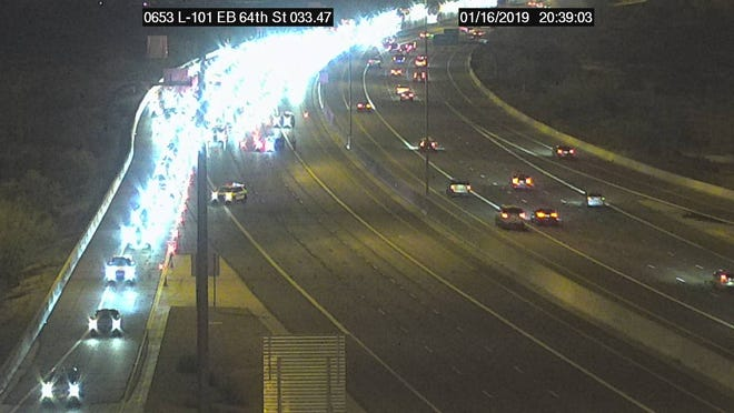 A rollover crash shut eastbound Loop 101 between 64th Street and Scottsdale Road in Phoenix on Jan. 16, 2019.