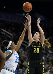 Oregon Ducks Sabrina Ionescu shoots over UCLA Bruins Lauryn Miller during an NCAA basketball game, Sunday, Jan. 13, 2019, in Los Angeles. (AP Photo/John McCoy)