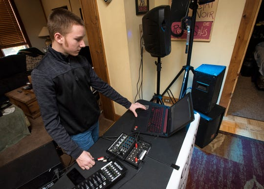 "Gunner Welch, 14, also known as ""DJ Gunns,"" DJ's in the living room of his family's Port Huron home Wednesday, Jan. 16, 2019."